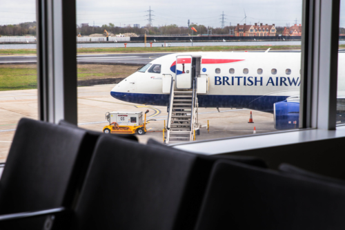 british airways embraer plane on the runway