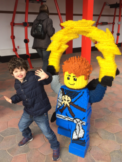 A boy with a LEGO Jay from Ninjago at Legoland in Billund