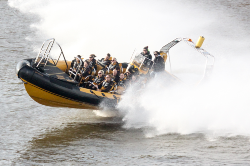 A boat full of people enjoy the Thames RIB Experience