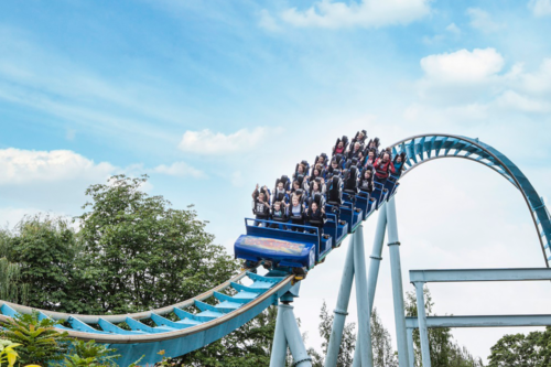 People ride Shockwave the stand-up roller coaster