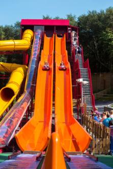 Children ride the Solar Splash water slides
