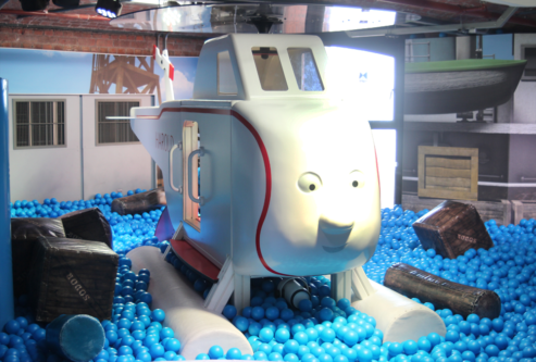 Harold the Helicopter's sits in the middle of a ball pool at Mattel Play