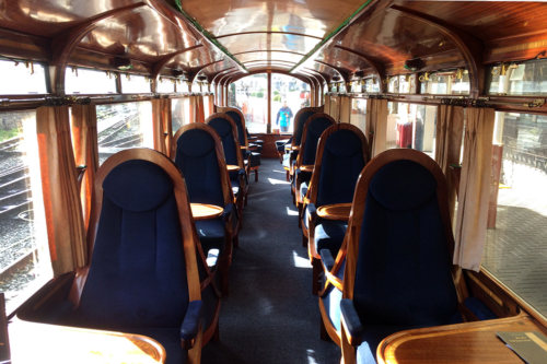 A carriage on the A child points at the Ffestiniog Railway