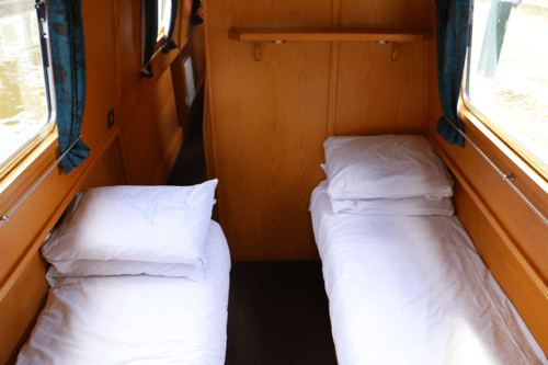 One f the bedrooms on the canal boat Askrigg with two single beds