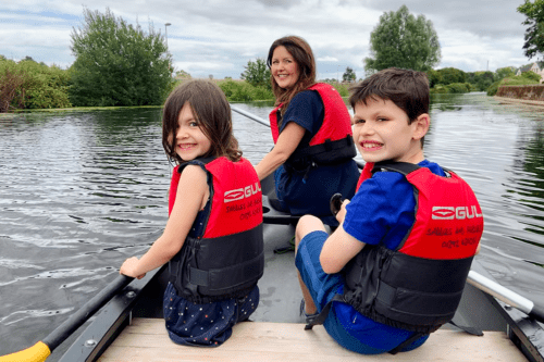 Family canoe ride on the River Exe in Exeter
