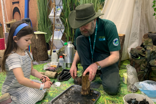 A ranger teache fire lighting at the Mini golf at the Caravan, Camping & Motorhome Show 2020