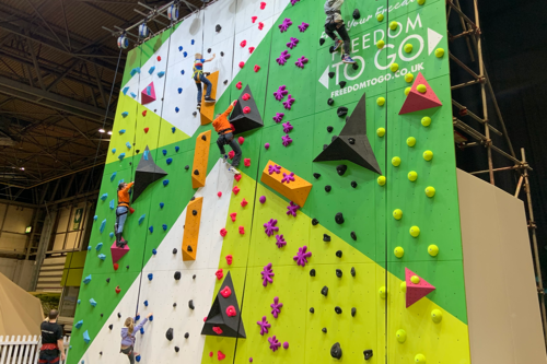 A climbing wall at the Children in a motorhome at the Caravan, Camping & Motorhome Show 2020
