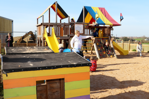 Sand pit outdoor play area at Cockfields Farm