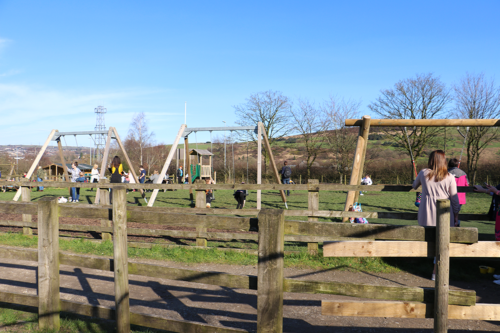 Swings and picnic tables at Cockfields Farm