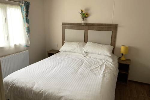 The double bedroom of our Tamar static caravan at Cofton Holiday Park