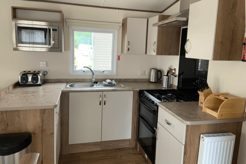 The kitchen area of our Tamar static caravan at Cofton Holiday Park