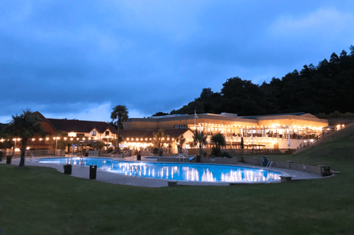 The outdoor pool and restaurants at Cofton Holidays