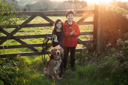 Children and a dog walking near to The Valley cottages in Truro, Cornwall