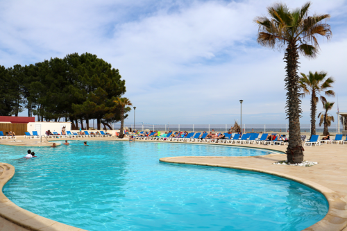 Swimming pool at Marina d'Erba Rossa holiday park in Corsica