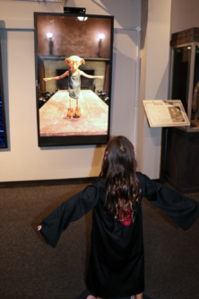 A girl uses the Dobby interactive motion screen at Harry Potter Studio in London