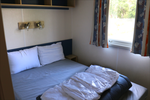 Double bedroom at three bedroo Eurocamp mobile home at Marina d-Erba Rossa