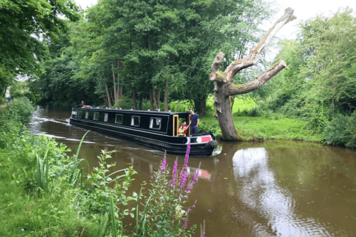A family travels on a canal boat