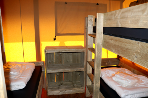 Three-person bedroom at a glamping lodge at Duinhoeve Holiday Park in Holland