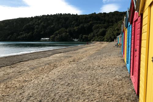 Beach huts at Llanbedrogg Beach