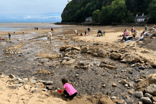 hildren play in the stream on Llanbedrog Beach