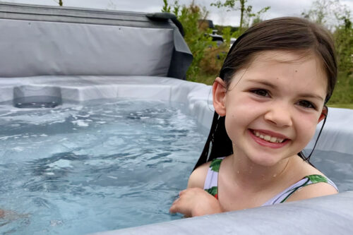 In the hot tub outside our wooden lodge at Love2Stay holiday park in Shropshire