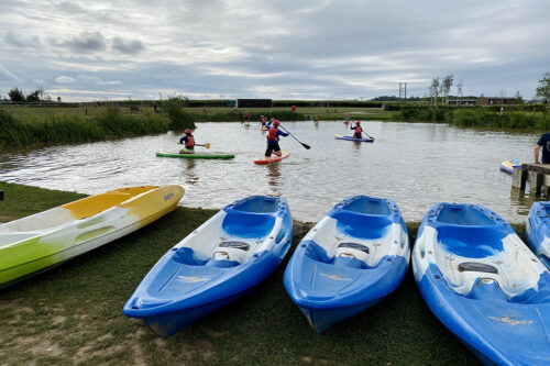 Paddle boarding on the lake at Love2Stay holiday park in Shropshire