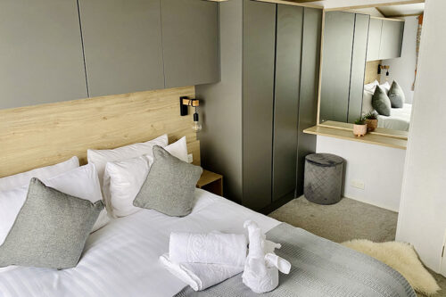 The double bedroom inside the lodge at Love2Stay holiday park in Shropshire