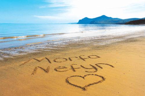 Nefyn beach with Morfa Nefyn and a heart written in the sand