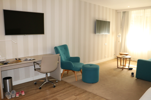 A suite at NH Amsterdam Central hotel with two tvs