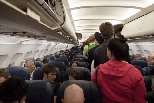 Passengers getting on a full plane