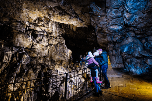Visitors explore Poole's Cavern