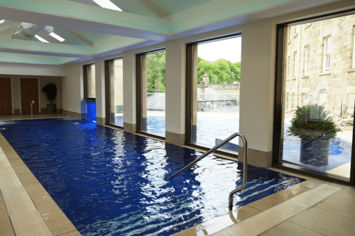 The indoor to outdoor rooftop swimming pool at the Buxton Crescent Hotel.
