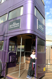 Children get on the Knight Bus at the Harry Potter Studio Tour in London