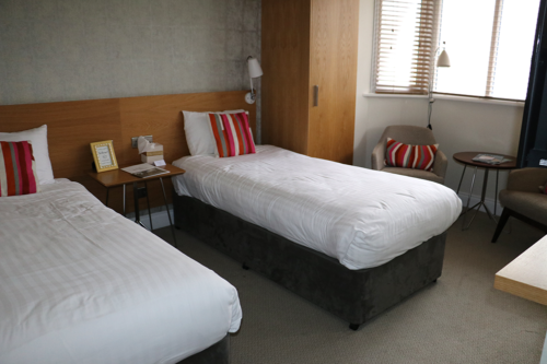 The other interconnecting room with single beds