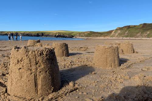 Sand castles at Whistling Sands beach