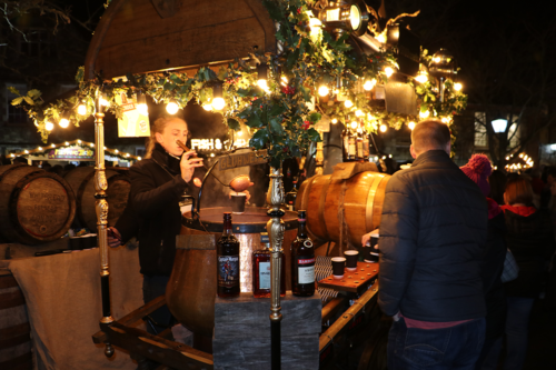 Buying mulled wine at Winchester Cathedral Christmas Market