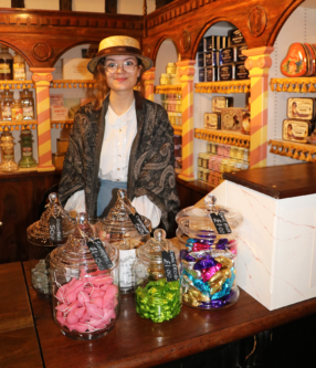 A sweet shop seller in a Victorian street at York Castle Museum